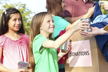girls-helping-kids-donations-charity.jpg